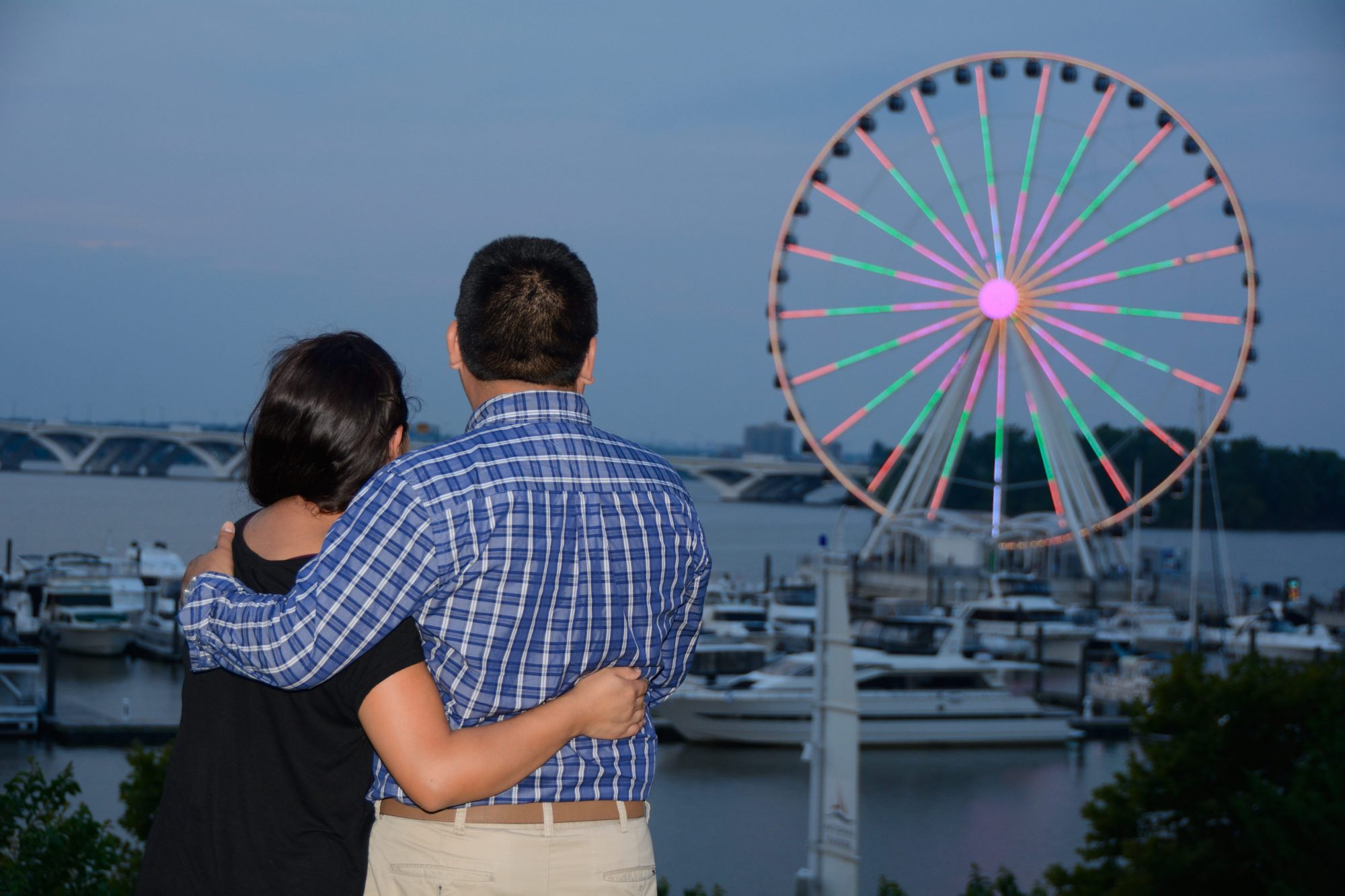 tomas hric photography stunning family and engagement photographer couple looking at ferris wheel