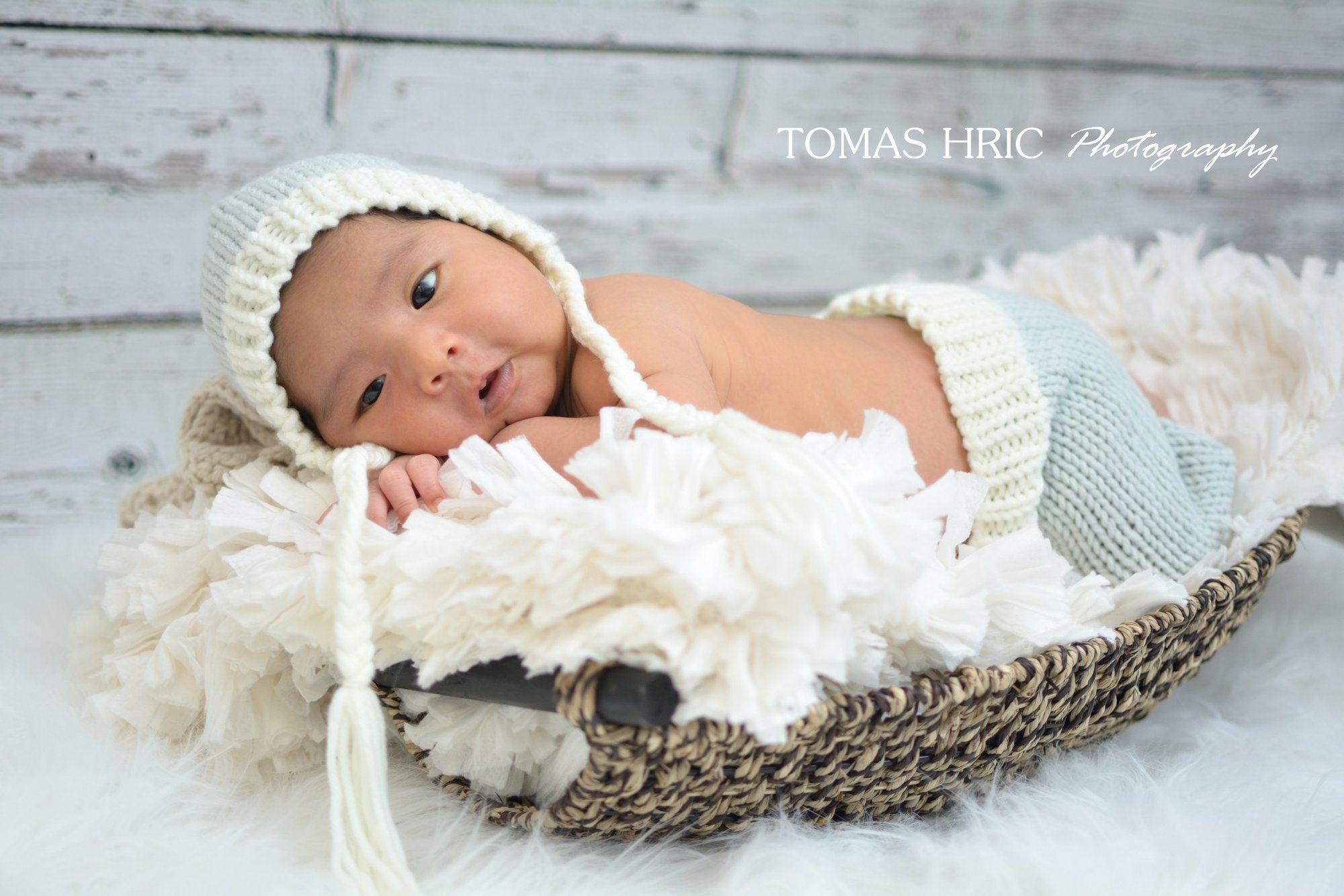 newborn picture of baby in a basket looking at camera in northern virginia