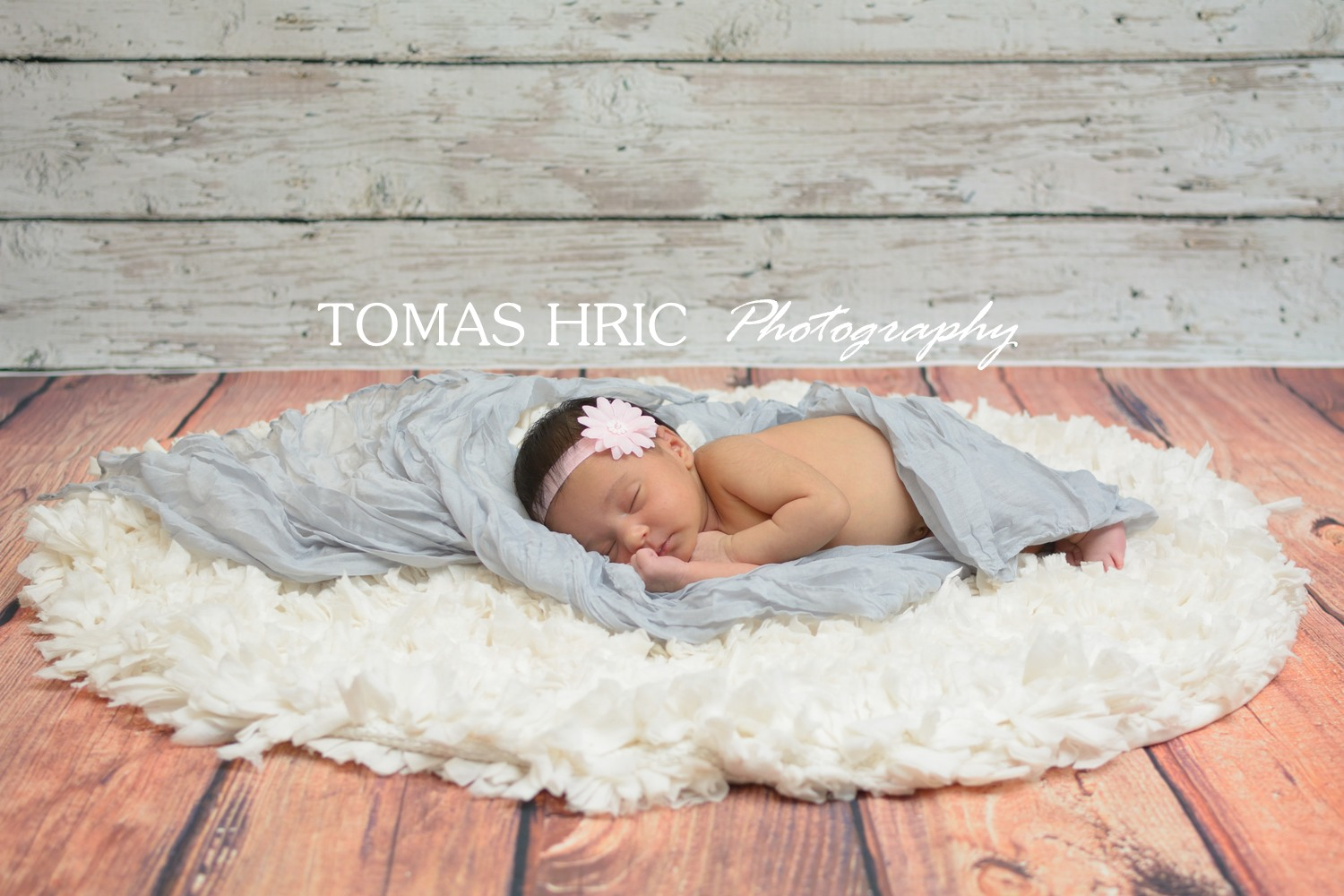Washington DC newborn photographer baby girl infant sleeping on a carpet on a wooden floor