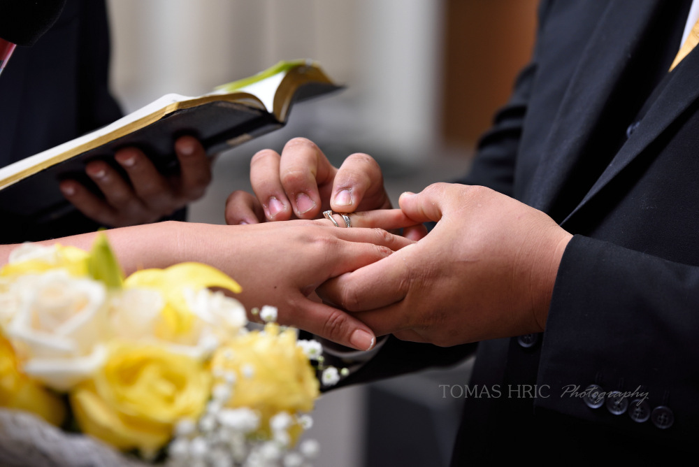 Groom putting a ring on bride Wedding in silver springs bethesda maryland washington DC tomas hric photography