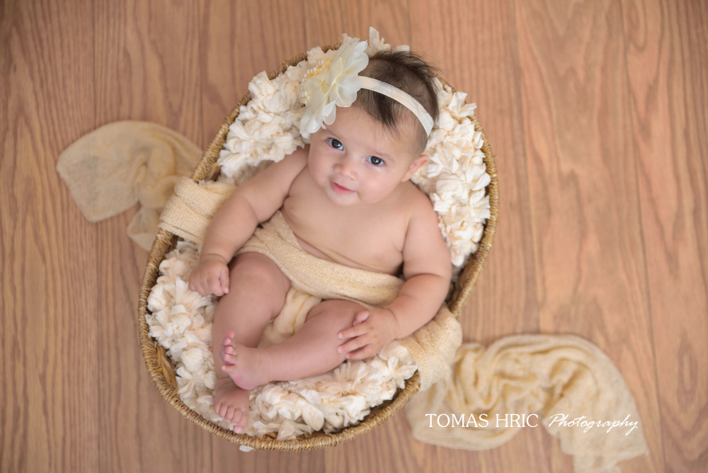Picture of newborn baby girl in a basket