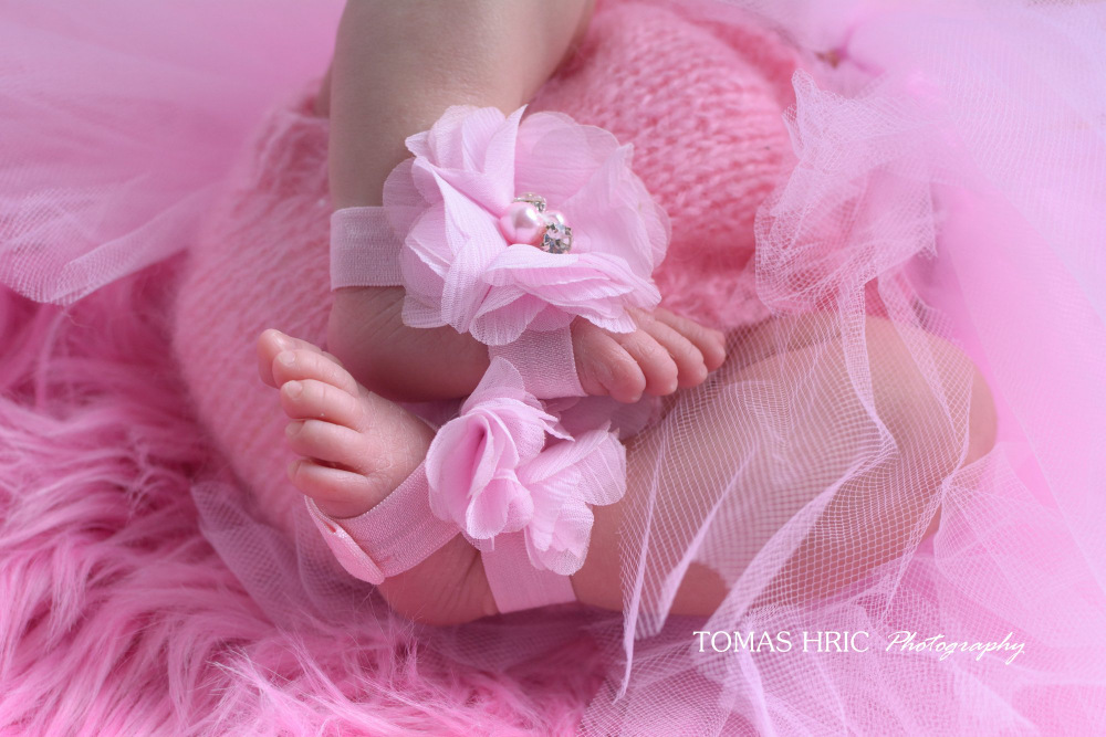 tiny-newborn-feet-in-pink-outfit-and-anklets-by-tomas-hric-photography-falls-church-virginia-best-northern-virginia-newborn-photographer